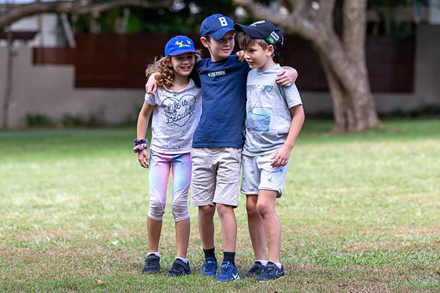 JuneProgram-3-kids-with-arms-around